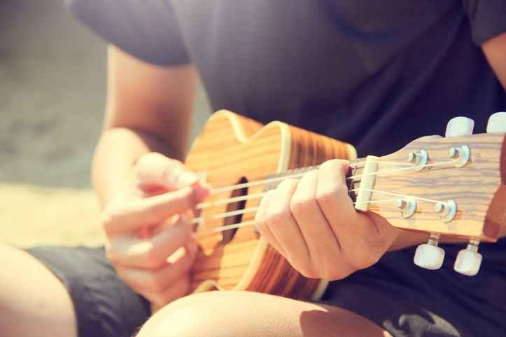 acoustic guitarist hands hobby