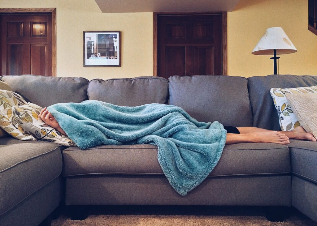 Woman-Sick-On-Couch